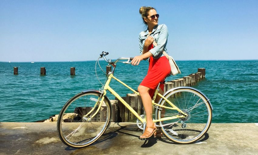 Side view of young woman riding bicycle