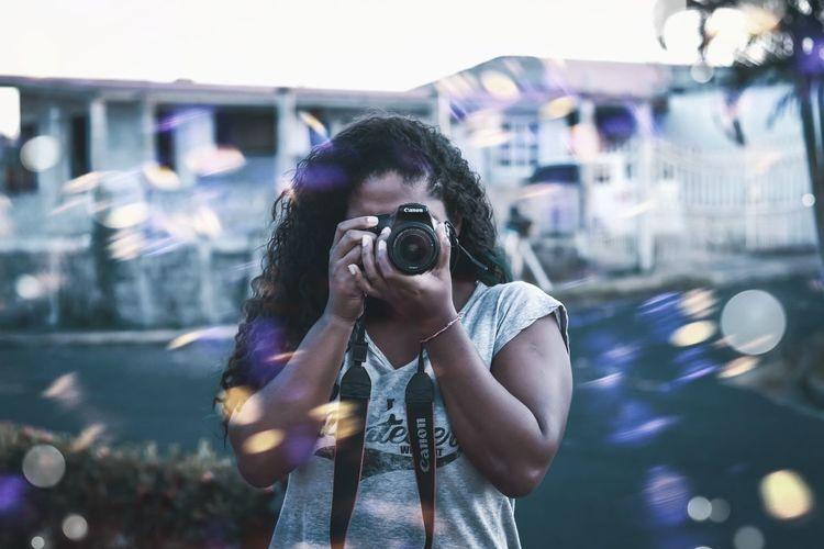 Woman photographing at camera