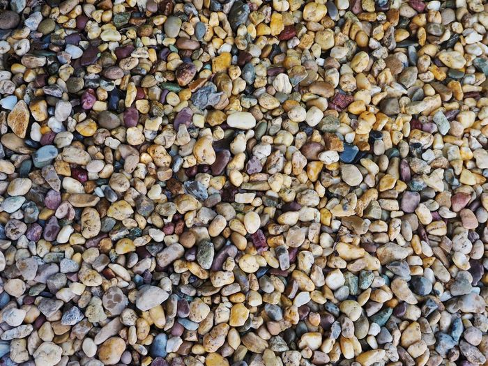 Decorative stone background texture Stone Decoration Gardening Background Wallpaper Pebble Beach Backgrounds Woodpile Full Frame Stack Heap Pebble Forestry Industry Timber Textured