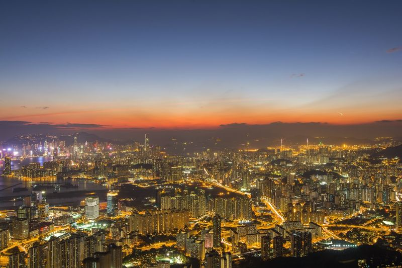 Hong kong city in sunset time Hongkongphotography Getty Images Getty Hongkong Photos Sunset Ciy Hongkongphotography Hongkong Photos Kowloon Hk HongKong Travel Destinations Built Structure Sunset Aerial View Night Outdoors Sky Modern