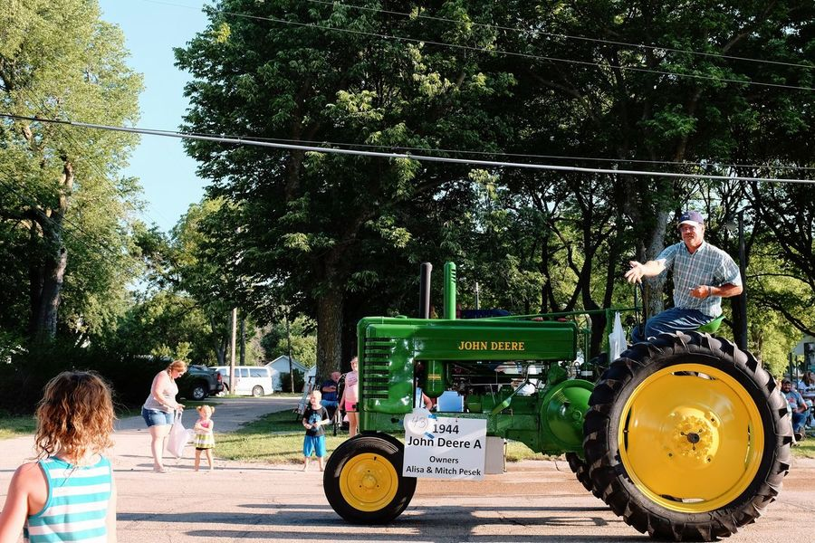 Old Settlers Picnic - Village of Western, Nebraska July 21, 2018 Americans Camera Work Community Event Farmer Getty Images Photo Essay Rural America Village Of Western, Nebraska Visual Journal Watching A Parade Adult Antique Tractor Architecture Casual Clothing City Day Eye4photography  Group Of People Incidental People John Deere Tractor Land Vehicle Long Form Storytelling Men Mode Of Transportation My Neighborhood Nature Old Settlers Picnic Old Settlers Picnic 2018 Outdoors Parade People Photo Diary Plant Real People S.ramos July 2018 Small Town Stories Standing Street Streetphotography Summer Transportation Tree