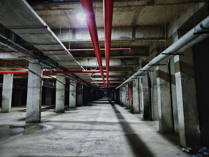 Leading lines, they say!! Underground Underground Parking Dark Alley Red Color Pop Low Light Low Light Photography Leading Lines Straight Lines Parking Lot HUAWEI Photo Award: After Dark City Architecture Built Structure Underneath