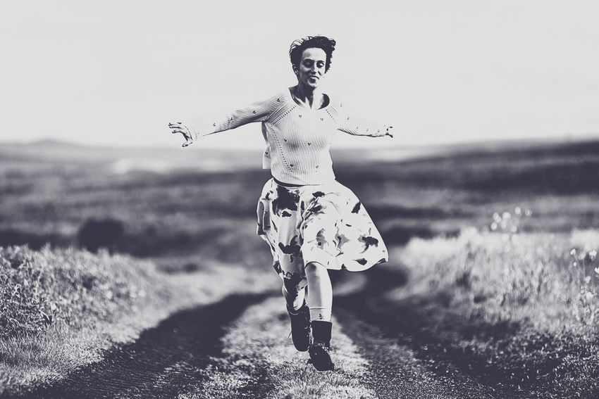 Woman in skirt running on a countryside road. Freedom concept. Black and white, toned, vintage effect Females Free Freedom Nature Running Woman B&w Concept Day Dust Road Film Noir Style Girl Land Leisure Activity Lifestyles Motion Movement Nature One Person Outdoor Outdoors Real People Speed Toned Way The Traveler - 2018 EyeEm Awards The Fashion Photographer - 2018 EyeEm Awards