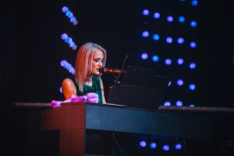 Piano Piano Moments Singing Singing Girl Passion Passion To What You Do Love Yourself Only Women One Person One Woman Only People Night Blond Hair Adults Only Indoors  Adult Arts Culture And Entertainment Skill  Young Adult One Young Woman Only