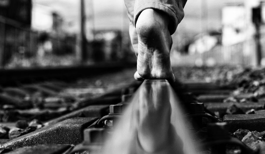 course Railway Line Leicacamera Blackandwhite EyeEm Best Shots Real People One Person Human Body Part Body Part Focus On Foreground Low Section Selective Focus Day Outdoors Unrecognizable Person Lifestyles Human Foot Human Limb City Human Leg Leisure Activity Metal