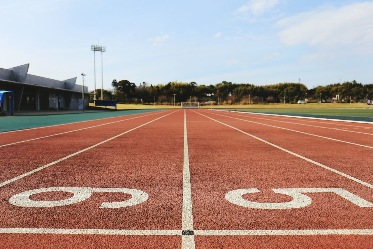 Number on running track against sky