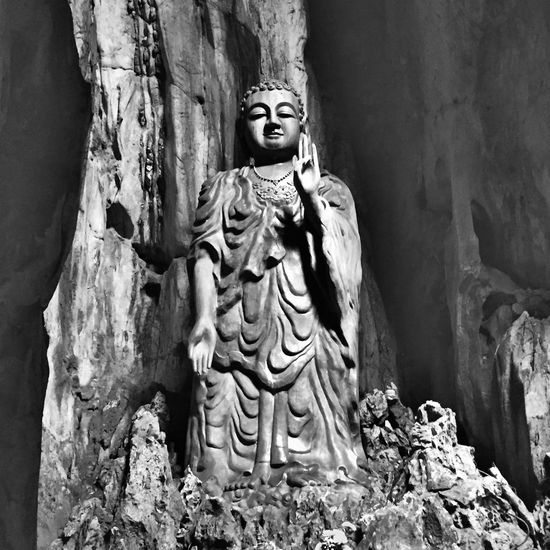 Spent a lovely, interesting but sweaty morning up in the Marble Mountains. Took more photos on the Canon AE1 but this was my pick of the 'tourist' ones. The caves were used as an army hospital by the local Vietnamese army during the war with the US ASIA Da Nang, Vietnam Black & White Black And White Vietnam Temples Buddha Buddha Statue Buddha Temple Buddha Image Sơn Trà Marble Mountains Da Nang Black And White Photography