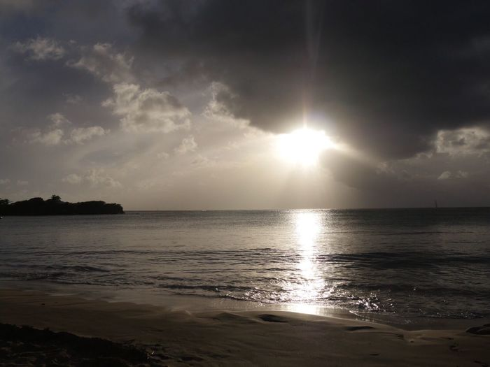 Travel Destinations Martinique Sainte Anne Les Salines Beach Sunset Sea Sun Nature Sunlight Beauty In Nature Water Sunbeam Sky Horizon Over Water Tranquility Scenics Tranquil Scene No People Outdoors Day