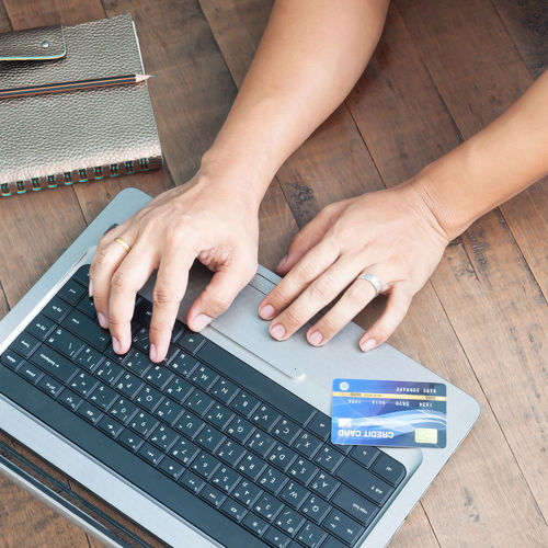 Man hands using laptop and credit card. Online shopping. Online banking shopping, buying, paying, ordering, commercial concept. Shopping online and using credit card. E-payment Ordering Buying Ecommerce Typing Cellphone Bill Keyboard Electronic Smart Bank Security Connection Web Lifestyle Digital White Male Commercial Shop Holding Man Smartphone E-commerce Buy Woman Finance Payments Business Communication Paying Pay Internet Wireless Shopping Credit Laptop Wallet Concept Commerce Using Computer Card African Technology Banking Mobile Online  Payment E