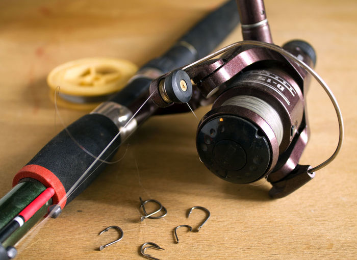 Close-up of fishing pole on table