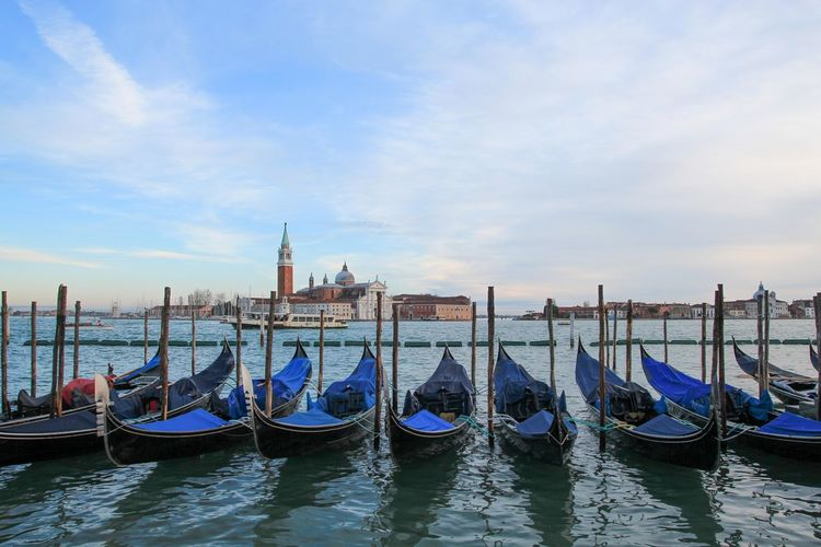blue gondola in venice Architecture Building Exterior Built Structure City Cloud - Sky Day Gondola Gondola - Traditional Boat Mode Of Transport Moored Nature Nautical Vessel No People Outdoors Place Of Worship Sky Tourism Transportation Travel Destinations Water Waterfront Wooden Post