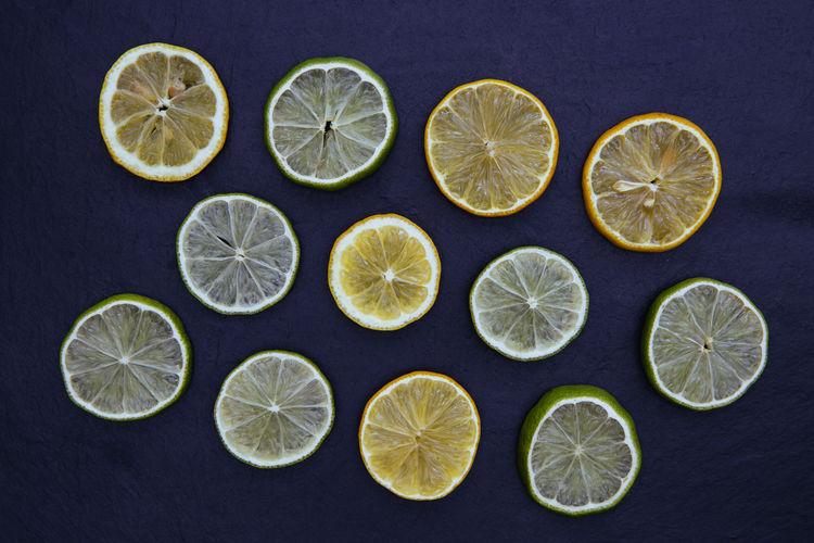 Lemon and lime GIN Alcohol Arrangement Choice Circle Citrus Fruit Colored Background Food Food And Drink Freshness Fruit Lemon Lime SLICE Studio Shot Tonic Variation