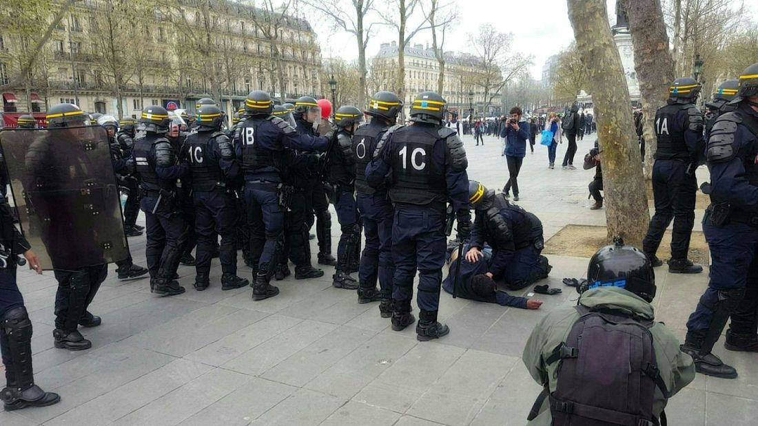 Old man, falled down by the teargas, finally help after screem from demonstrator Demonstration Paris