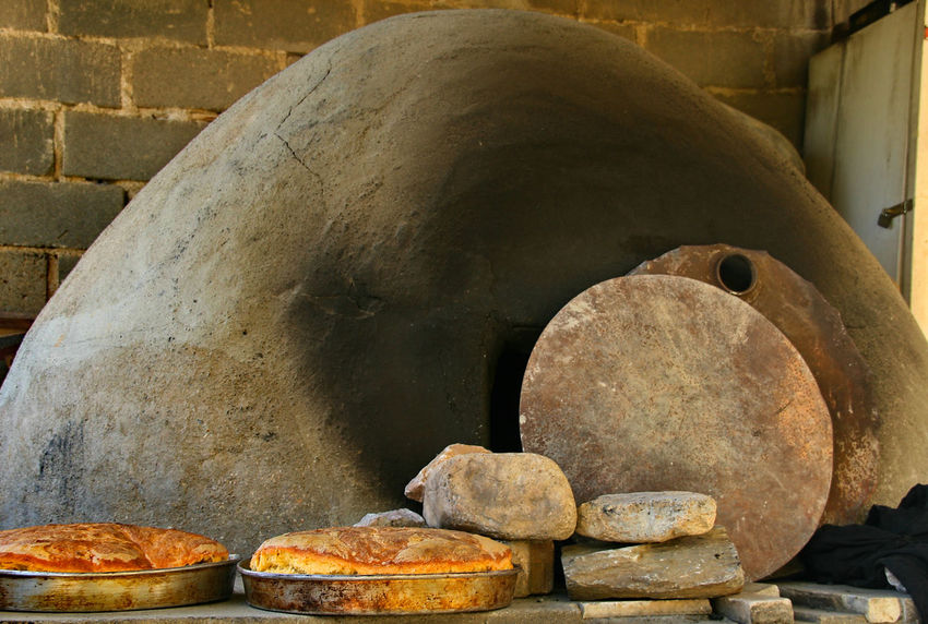 freshly baked bread and an outdoor bread oven Bread Oven Fresh Fresh Baked Healthy Eating Home Made Iznik No People Outdoors Oven Overcast Stones Turkey