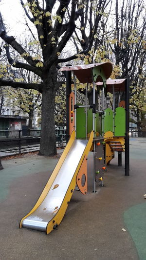 Playground Equipment Rain Trees Cityscape Wet Leaves Colourful