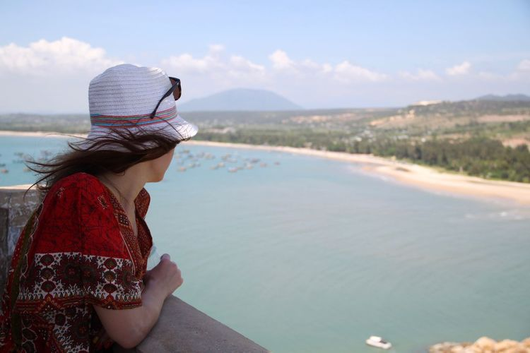 Woman looking at beach while standing at observation point