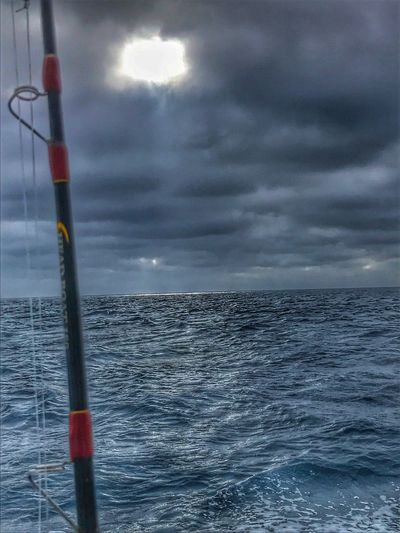 Sun Breaking Through Out At Sea On The Way To The Reef Fishing Charter Fishing Rod Sea Water Sky Cloud - Sky Nature Outdoors No People Horizon Over Water Day Nautical Vessel Beauty In Nature Breathing Space