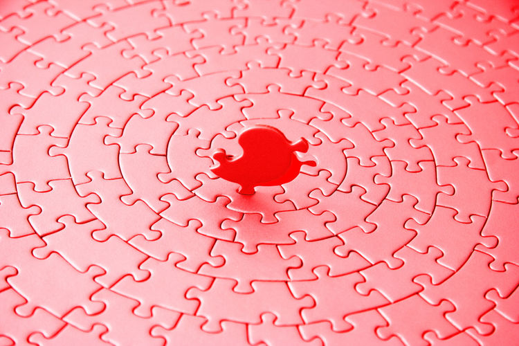 Full Frame Shot Of Red Jigsaw Puzzles