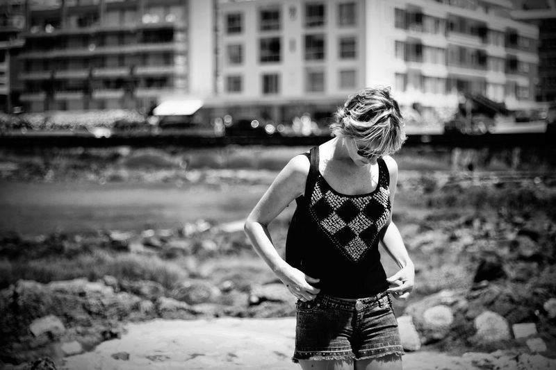 Woman in tank top standing outdoors