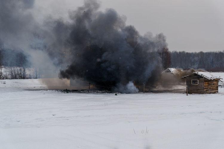 View of black smoke in field