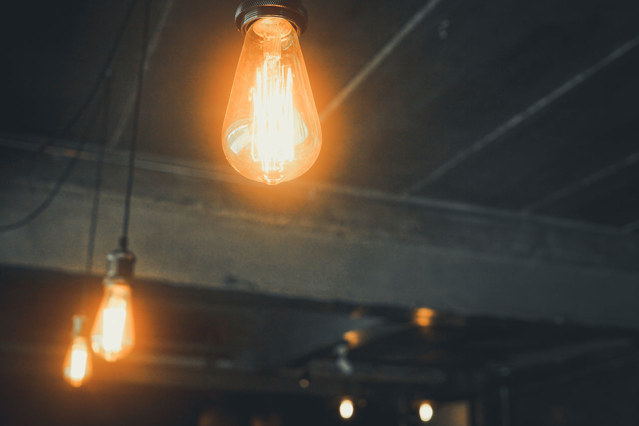 illuminated, lighting equipment, electricity, light bulb, glowing, electric light, transparent, light, glass - material, no people, filament, indoors, light - natural phenomenon, focus on foreground, close-up, technology, low angle view, night, orange color, fuel and power generation, power supply, electrical equipment, electric lamp