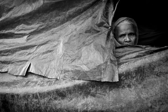 """""""I have lost all the male members of my family in the genocide. Only female survivors in my family were able to cross the border. I do not know what the future holds for us"""" Portrait of a rohingya refugee. It is estimated that 4,10,000 rohingya refugees crossed over to Bangladesh from Myanmar. UN has termed it as textbook example of 'ethnic cleansing'. Bangladesh Genocide Photojournalism Rohingya Rohingya Refugees Crisis Documentary Myanmar One Person Real People Survivor Black & White Friday"""