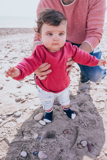 Portrait of cute baby girl on sand