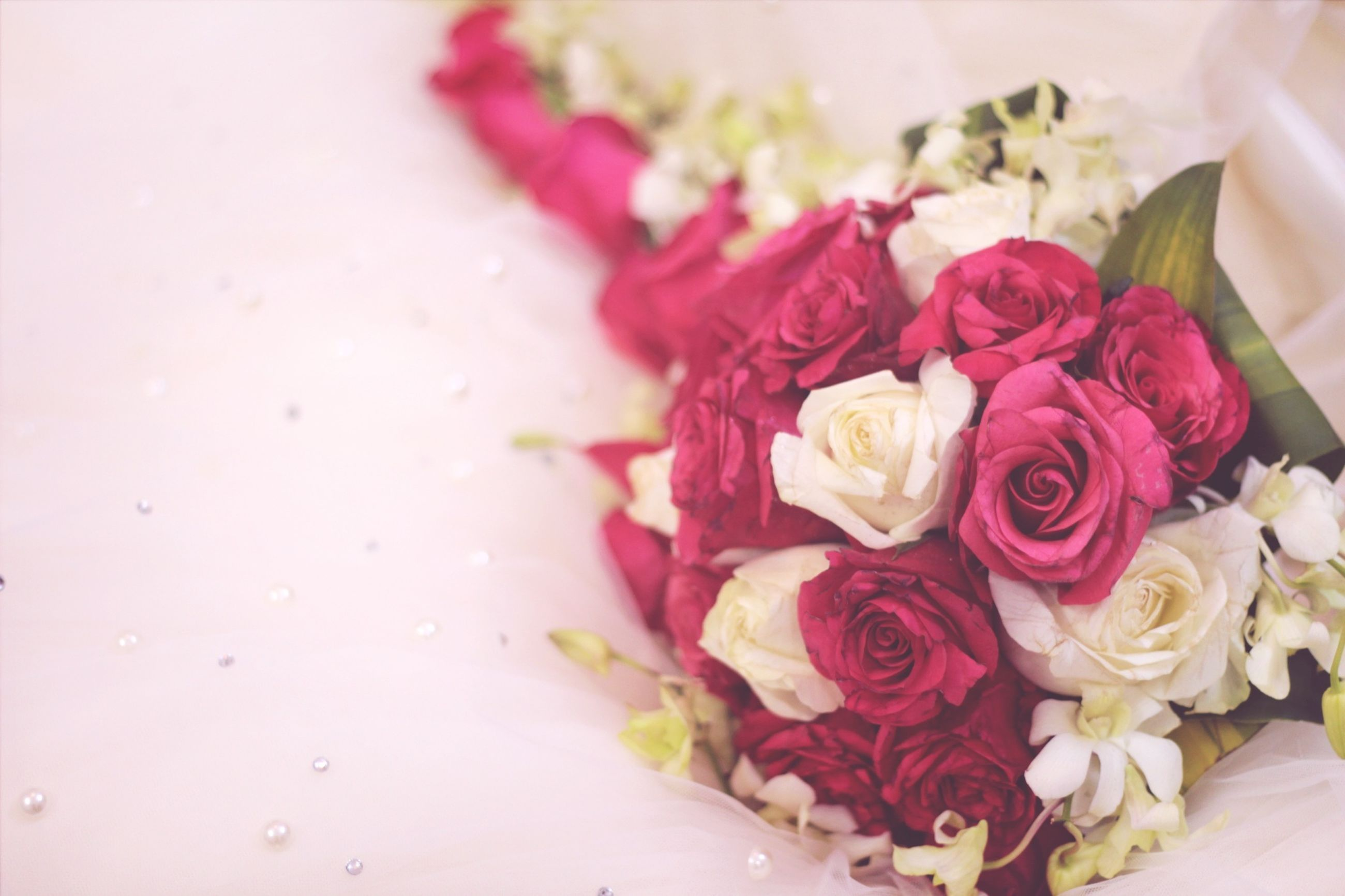 flower, indoors, freshness, petal, rose - flower, close-up, bouquet, fragility, flower head, bunch of flowers, vase, table, rose, still life, high angle view, decoration, beauty in nature, no people, focus on foreground, pink color