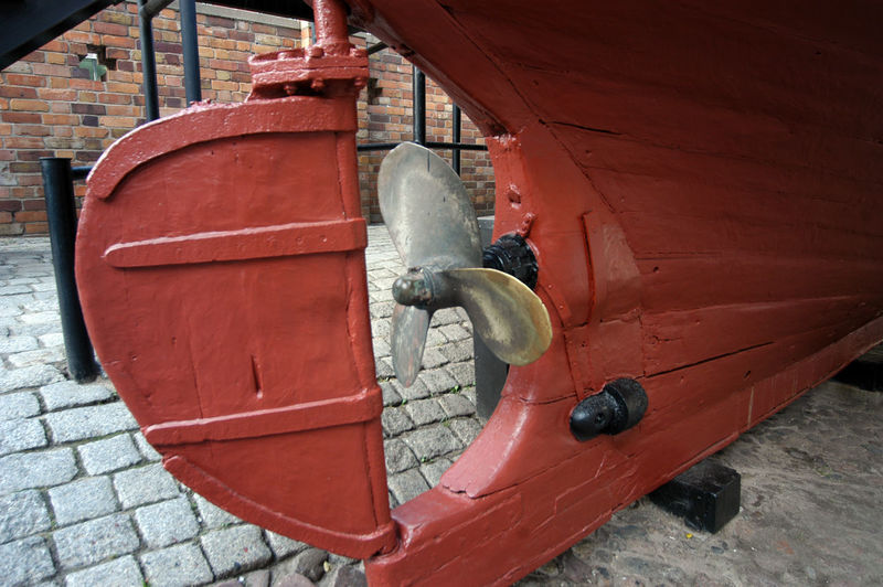 High angle view of old boat moored on wall