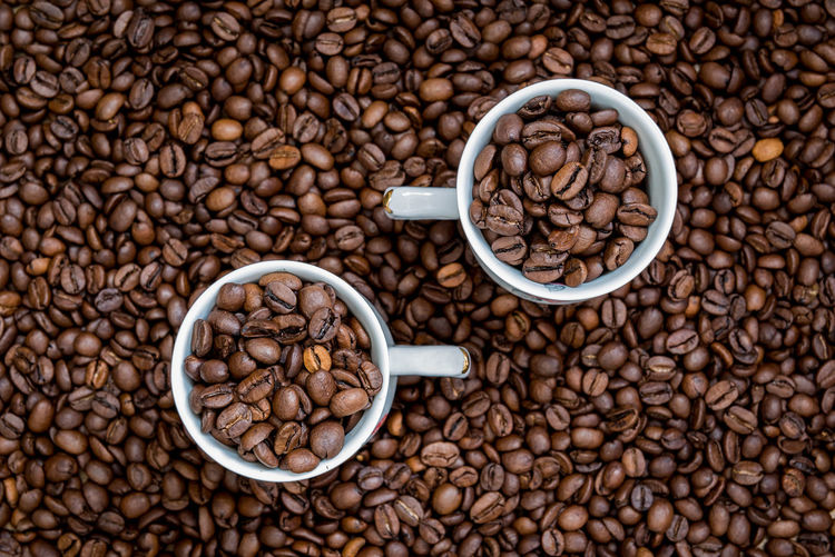 Two cup full of coffee beans with coffee beans background Backgrounds Bean Brown Cafe Close-up Coffee Coffee - Drink Coffee Bean Coffee Crop Coffee Cup Copy Space Cup Food Food And Drink Freshness Glass Indoor Mug No People Raw Coffee Bean Roasted Roasted Coffee Bean Still Life Wood Wooden