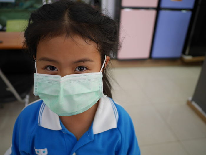 Portrait of girl wearing pollution mask