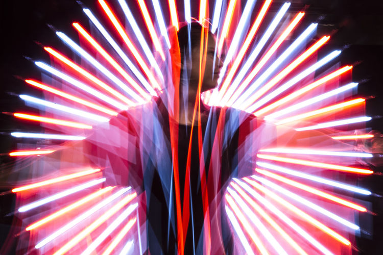 Illuminated One Person Multi Colored Night Front View Motion Red Real People Blurred Motion Indoors  Pattern Arts Culture And Entertainment Long Exposure Standing Adult Light - Natural Phenomenon Lighting Equipment Glowing Unrecognizable Person Human Arm Laser Nightlife Capture Tomorrow