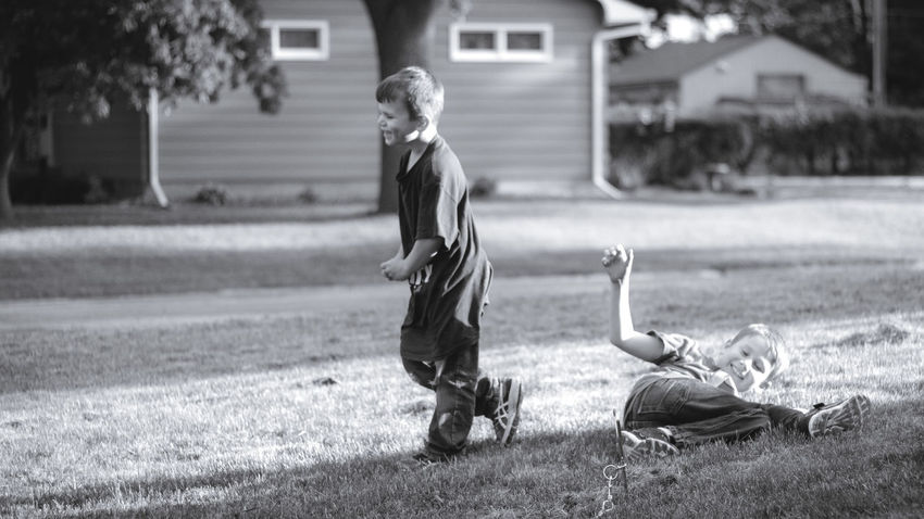 Laughing Blackandwhite Boys Brothers Childhood Day Elementary Age Field Focus On Foreground Full Length Grass Happiness House Live For The Story Outdoors People Real People Togetherness Two People