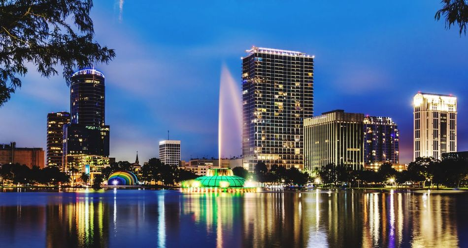 Architecture Building Exterior Skyscraper Reflection Water Modern Illuminated Built Structure Sky City Night Waterfront No People Tree Outdoors River Growth Cityscape Urban Skyline Florida Orlando Orlando Florida Lake Eola Lake View Lake Eola Park Been There.