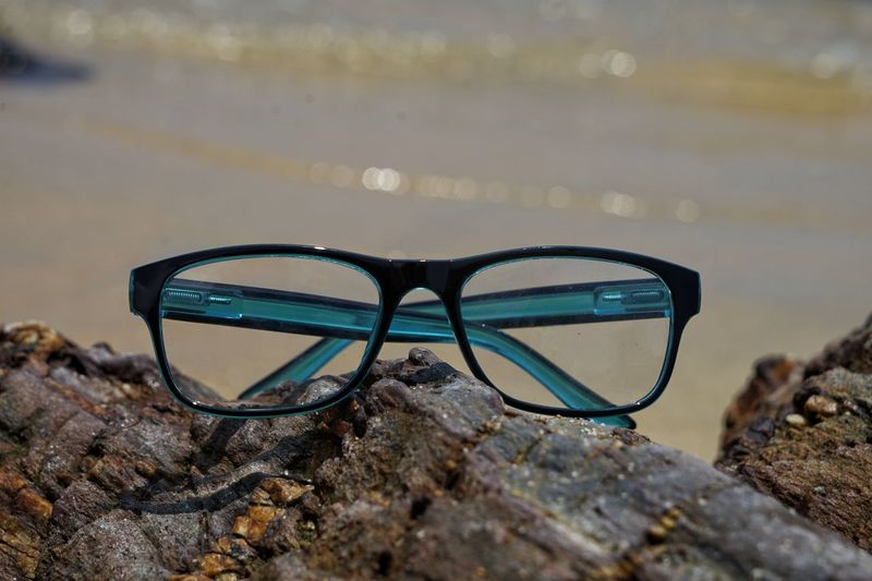Glasses Eyeglasses  Rock - Object Rock Close-up Solid No People Personal Accessory Nature Transparent Glass - Material Focus On Foreground Day Selective Focus Outdoors Beach Land Still Life Water Reflection Eyewear