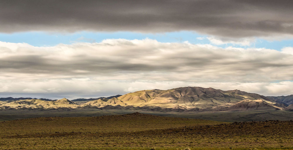 Photo taken in Mongolia Mongolia Zuun Bayan Ulaan Cloud - Sky Beauty In Nature Tranquil Scene Remote Sunset Hills Southern Mongolia