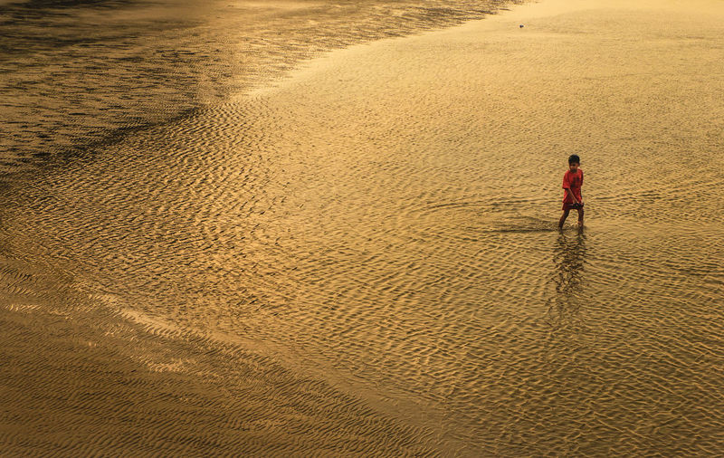 Full Length Of Boy Wading In Sea