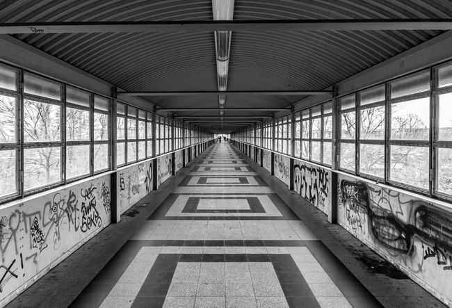 Berlin Photography Black & White City Life Footbridge Pedestrian Walkway Urbam Architecture Black And White Bridge - Man Made Structure Built Structure Covered Bridge Day Indoors  No People Pedestrian Bridge S-bahnhof Street Photography Streetphoto_bw Subway Station Symmetry The Way Forward Windows