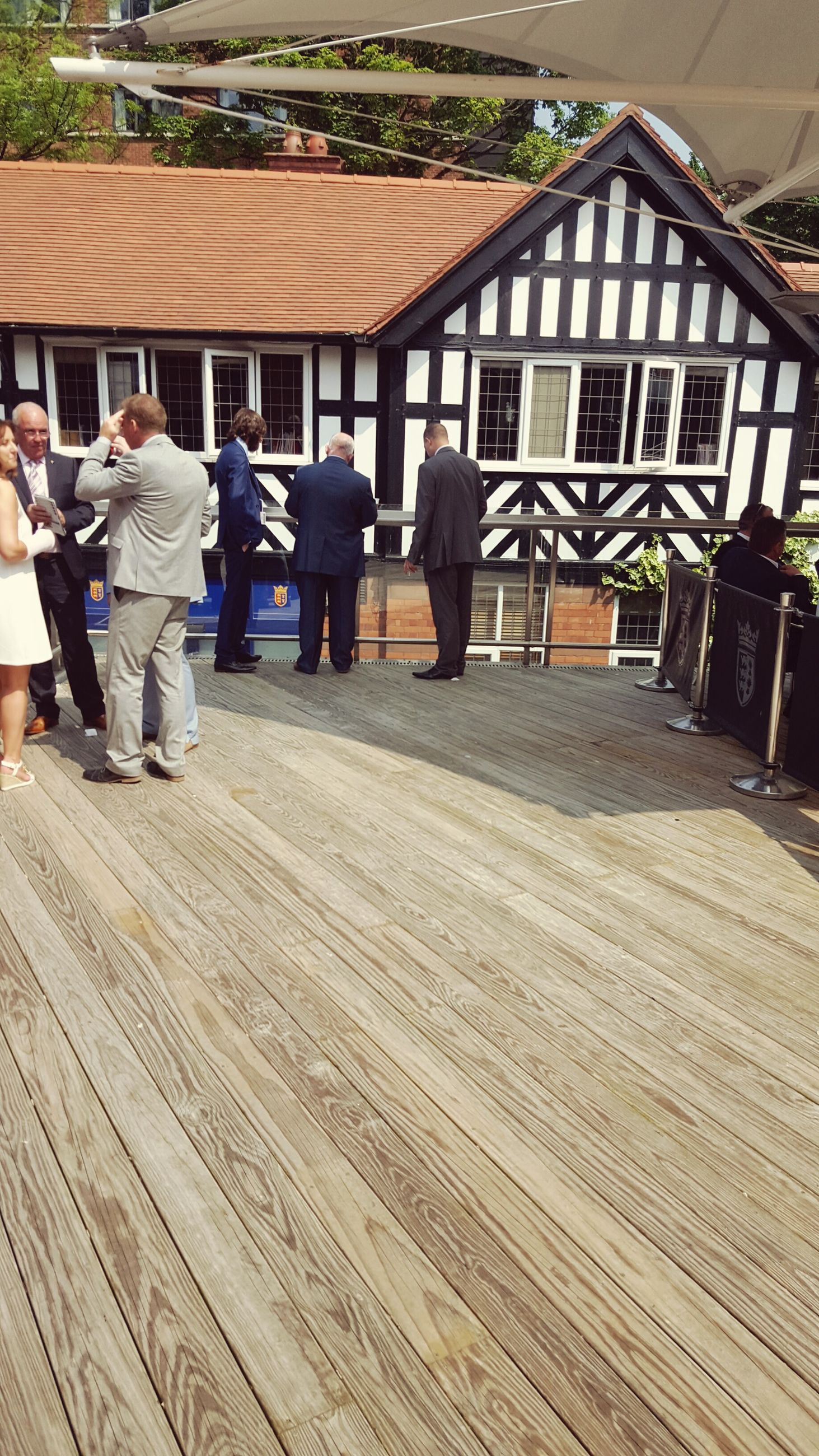 building exterior, built structure, architecture, men, house, lifestyles, roof, leisure activity, person, day, residential structure, outdoors, rear view, walking, full length, sitting, wood - material