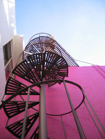 Building Exterior Circular Stairway Going Up Going Upstairs Metal Stairs Pink Color Rooftop Stairway Spiral Stairways
