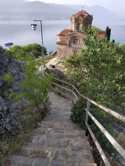 Staircase leading towards building by sea