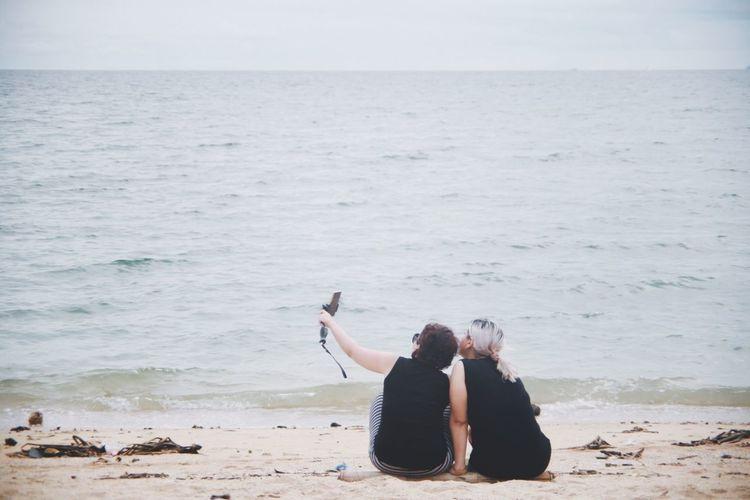 Friends taking selfie at beach