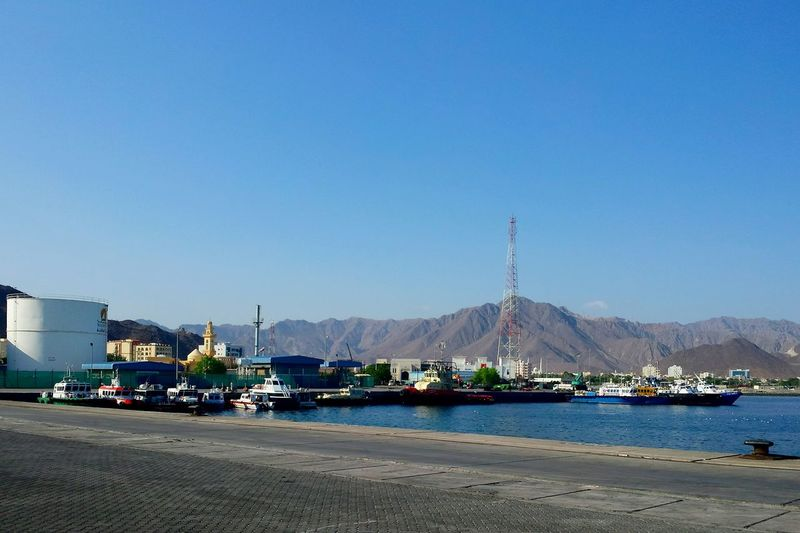 Travel Destinations Khor Fakkan Harbour & Ships Harbour Blue Sea And Blue Sky Ladyphotographerofthemonth Architecture Beauty In Nature Nautical Vessel Sea Beach Clear Sky Sky Harbor No People Tourism City Transportation Moored Outdoors Business Finance And Industry Sailboat Day Nature Beauty In Nature Adapted To The City Miles Away