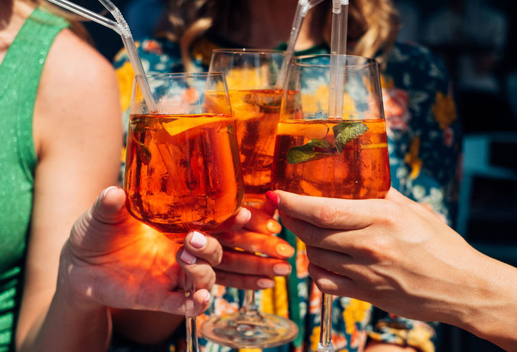woman toasting with aperol spritz Adult Alcohol Celebration Celebratory Toast Cocktail Drink Drinking Glass Finger Focus On Foreground Food And Drink Friendship Glass Group Of People Hand Holding Human Body Part Human Hand Lifestyles Real People Refreshment Togetherness Women The Still Life Photographer - 2018 EyeEm Awards