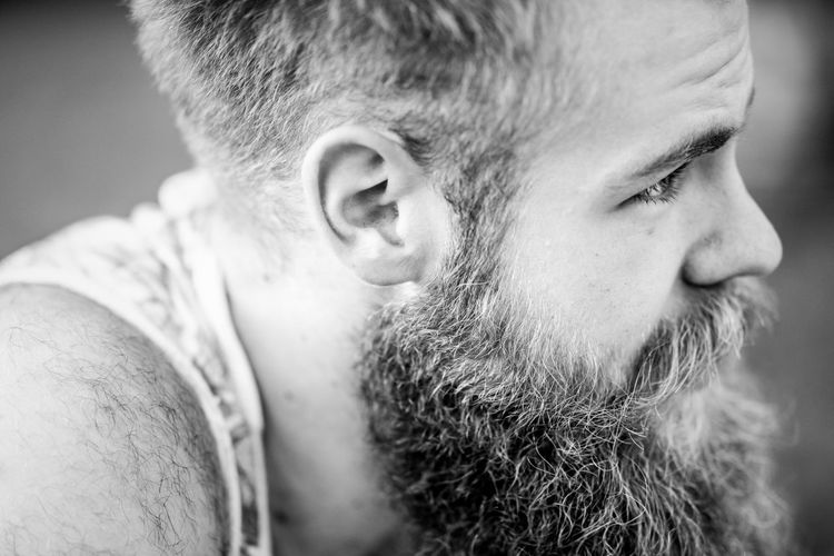 Side view of bearded man
