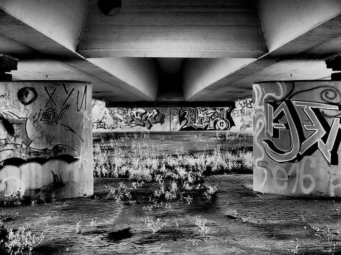 Graffiti on bridge over river