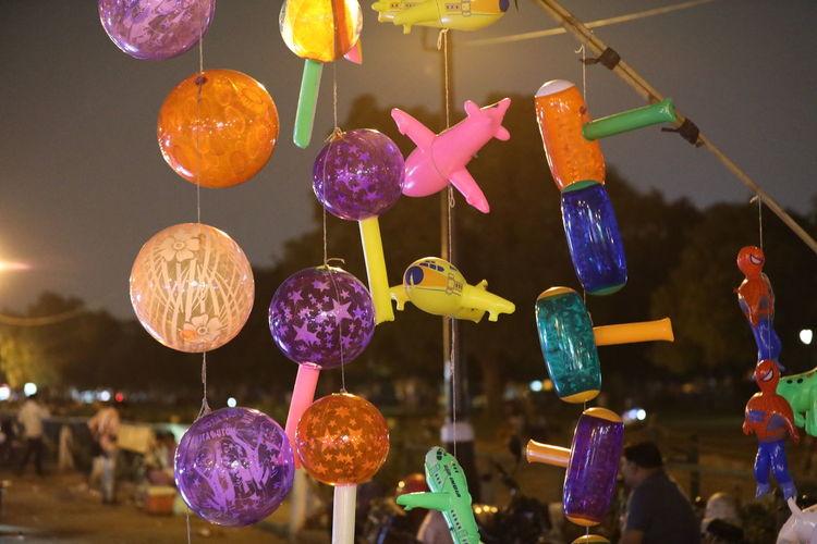 Low angle view of illuminated lanterns hanging at market