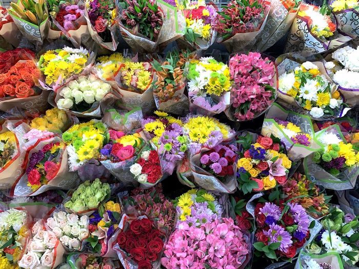 High angle view of various flowers on market stall