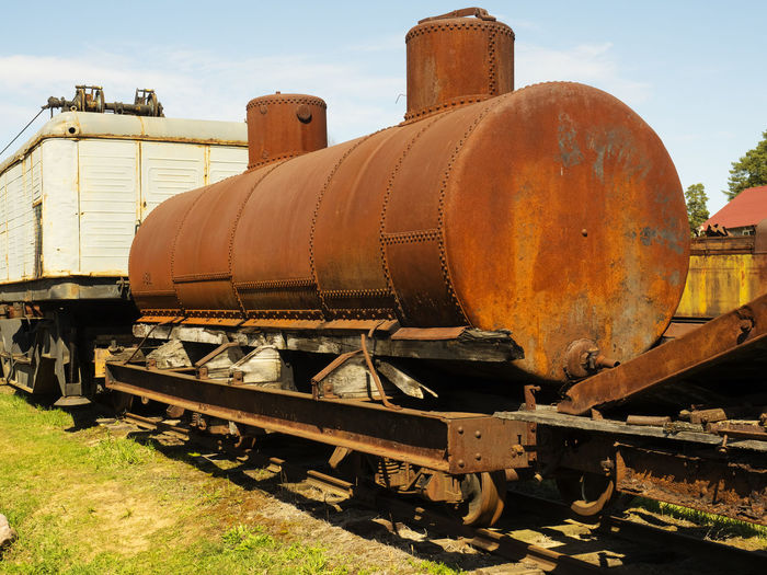Abandoned Day Decline Deterioration Metal Mode Of Transportation Nature No People Obsolete Old Outdoors Rail Transportation Railroad Car Railroad Track Rusty Shunting Yard Sky Sunlight Track Train Train - Vehicle Transportation
