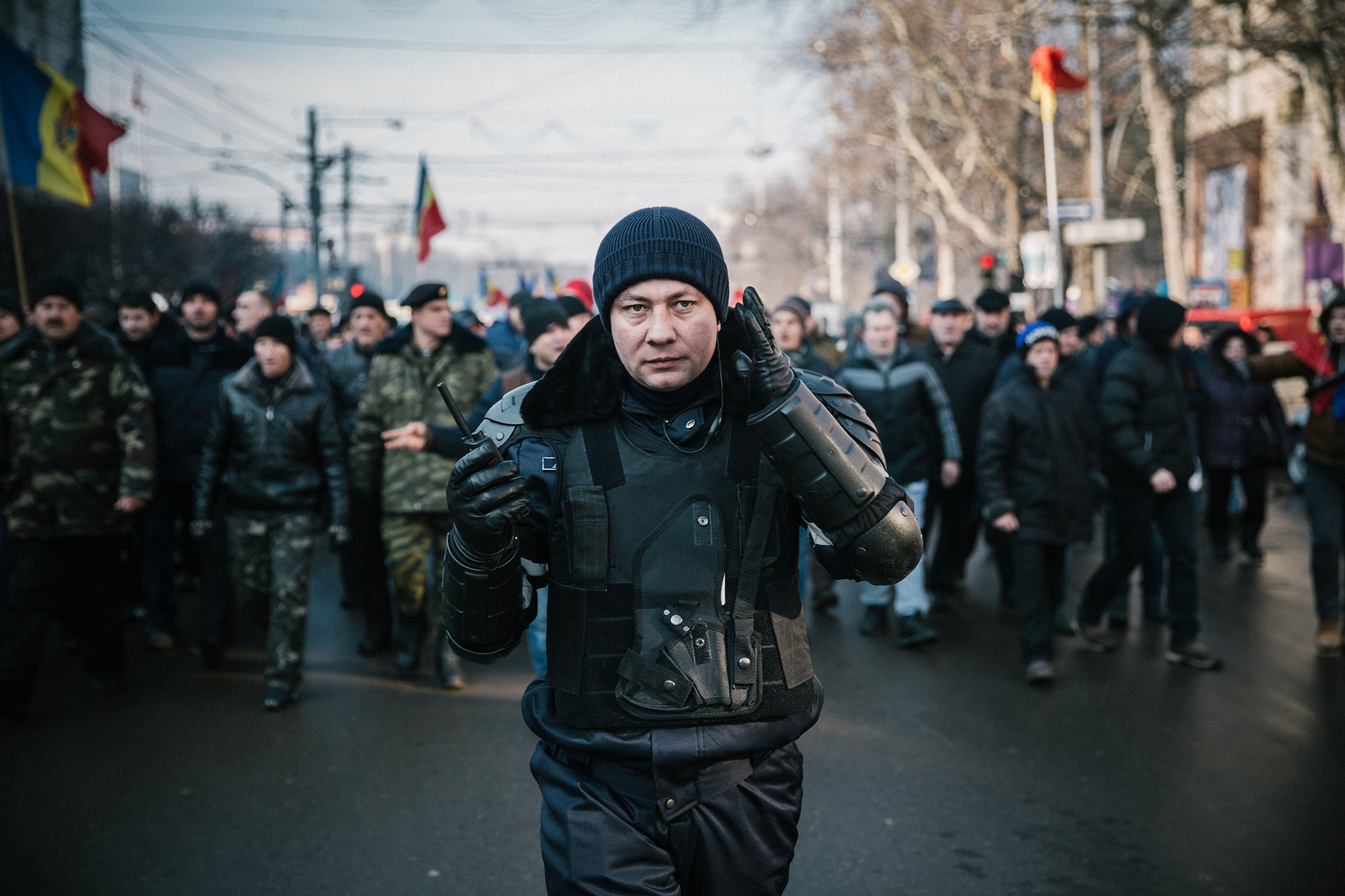 front view, real people, men, day, outdoors, large group of people, warm clothing, crowd, young adult, city, riot, adult, people